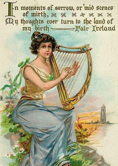 A woman plays a harp she is holding on her knees