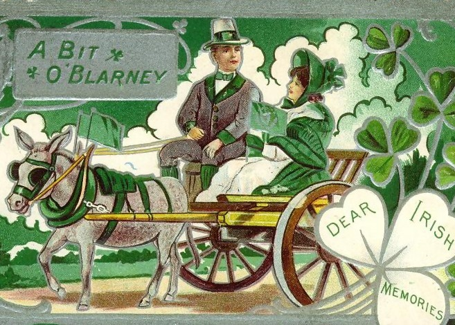 A man and woman on a horse and trap with shamrock decorations