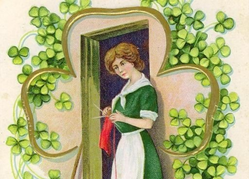 A woman by a cottage door knitting surrounded by a shamrock frame