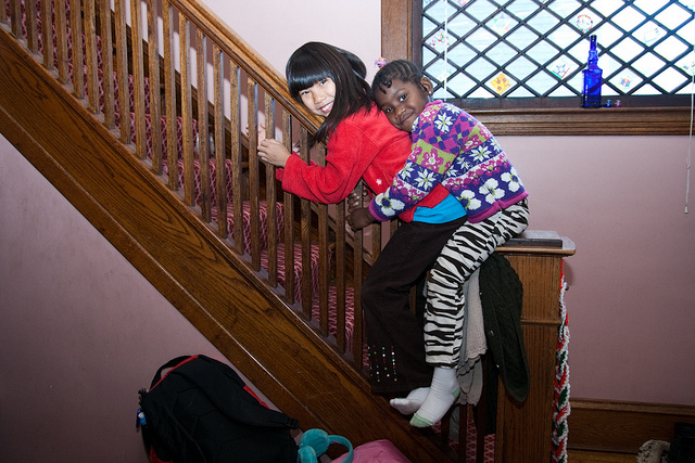 two girls on bannister