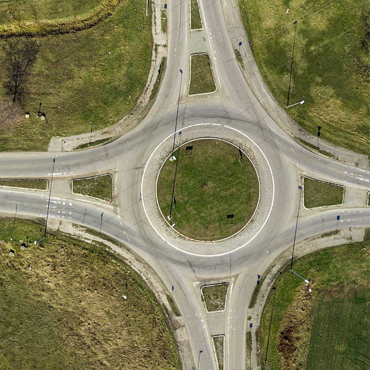 Aerial view of a roundabout with four roads accessing the junction