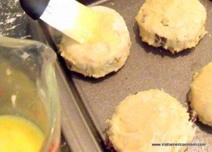 Brushing egg wash onto the top of Irish Raisin Tea Scones