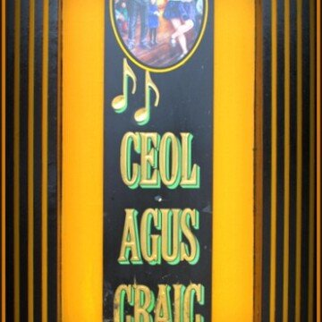 An Irish pub sign saying ceol agus craic or music and fun
