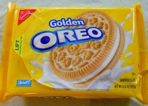 A packet of Golden Oreos with yellow cover and cookie sandwich