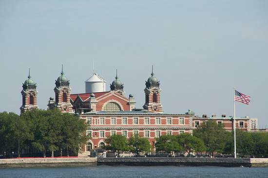 The buildings on Ellis Island with an American flag