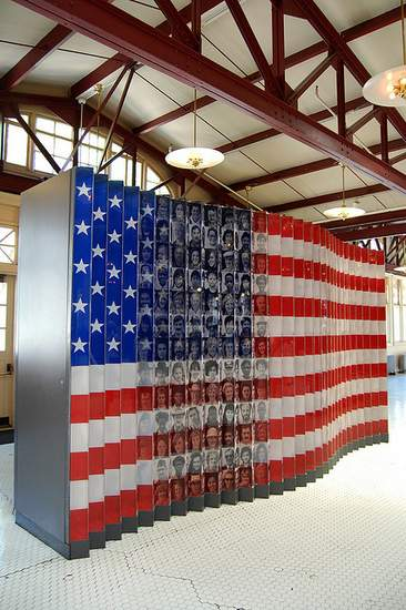American flag with superimposed images of immigrants on display at Ellis Island Immigrant Museum
