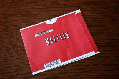 A red Netflix envelope with movie CD
