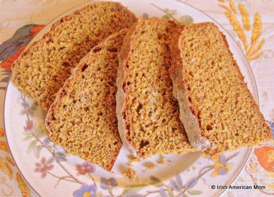 Slices of freshly cut Irish brown soda bread on a plate