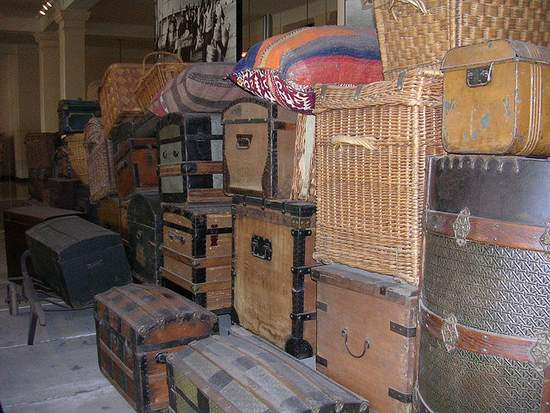 Suitcases, trunks and wicker traveling cases in a stack