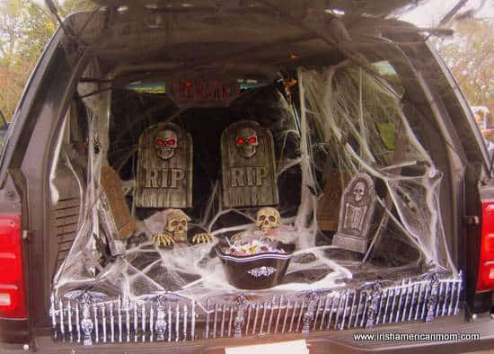 A trunk decorated with grave stones and skeletons for Halloween