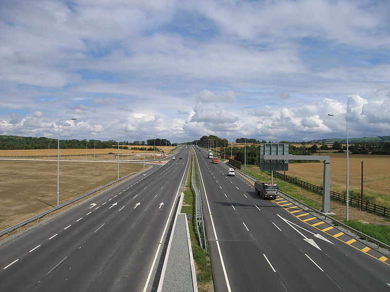 A motorway with fields