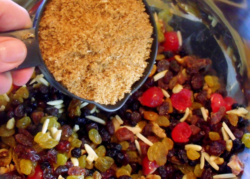 Adding brown sugar to fruit for a plum pudding