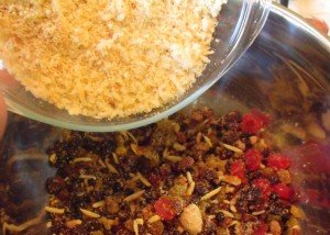 Adding breadcrumbs to a plum pudding mix