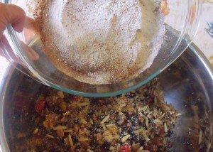 Mixing dry ingredients for a plum pudding