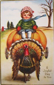 vintage boy driving a pumpkin carriage with a turkey