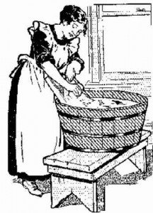 Washing clothes in an old tub