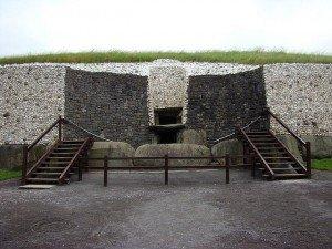 Steps leading over large Ogham stones at the entrance to Newgrange