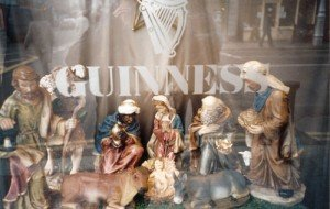 A nativity set in a Dublin pub behind a sign for Guinness