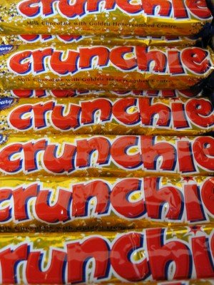 A close up of a Crunchie chocolate bar wrappers