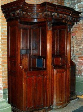 Ornate wooden Italian open confessional