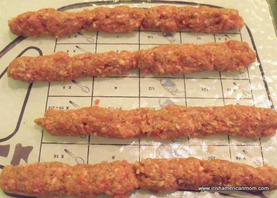 Sausage meat formed in rolls