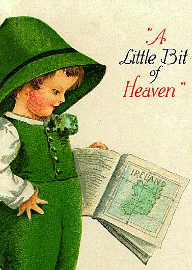 Child in green clothes looks at a map of Ireland in a book