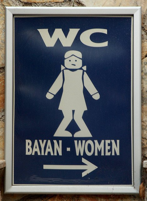 Toilet sign for women with a cross legged woman