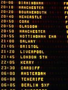 List of airplane departures and times on a sign at Dublin Airport