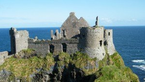 The ruins of Dunluce Castle in County Antrim sitting high on a cliff above the ocean