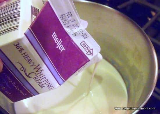 Adding heavy whipping cream to saucepan