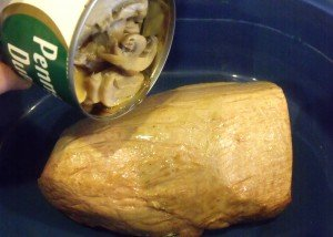 tinned mushrooms being poured over a seared roast beef joint
