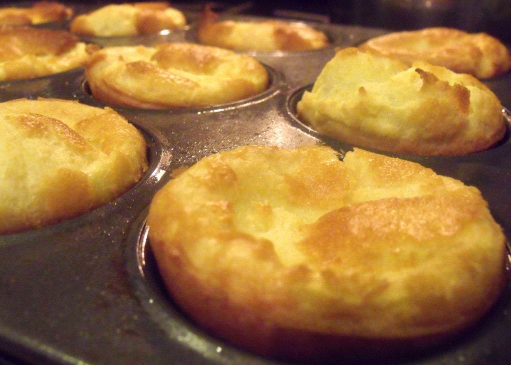 Freshly baked Yorkshire puddings in a muffin tray just out of the oven