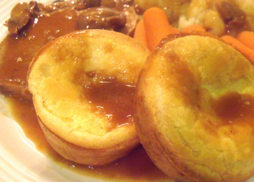 Roast beef served with carrots and Yorkshire pudding