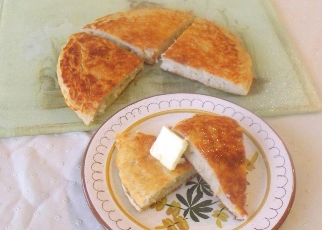 A boxty potato pancake cut into farls on a plate