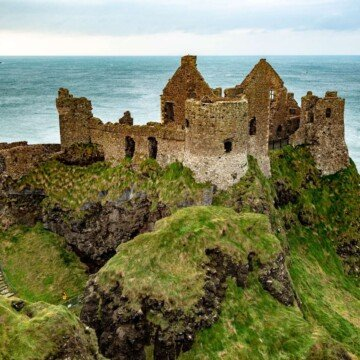 A ruined castle on a high cliff beside the ocean