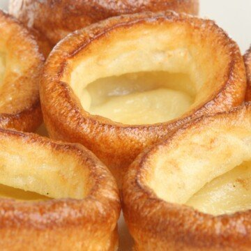 Golden and risen Yorkshire puddings in a close up shot