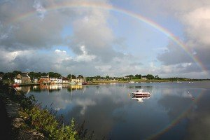 A full arc rainbow with reflection in the water in Kinvara County Galway