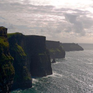 Cloudy gray skies over the Cliffs of Moher in Ireland