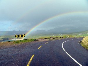 A rainbow arching over a road near Dingle in County Kerry Ireland