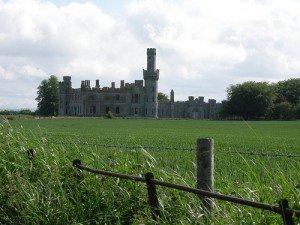 A ruined castle in a green field