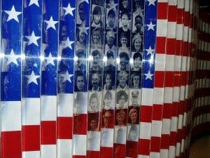 United States flag artwork with showing faces of immigrants at Ellis Island
