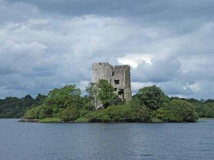 Castle ruins on an island in the middle of a lake in Ireland