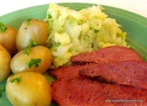 A plate with boiled potatoes, corned beef and Irish style cabbage