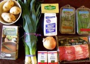 potatoes, broth, leeks onion and herbs for potato and leek soup