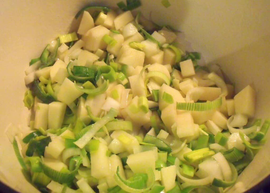 Saute leeks, potato and onion