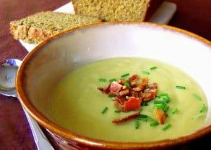Bowl of Irish potato and leek soup with sliced brown bread