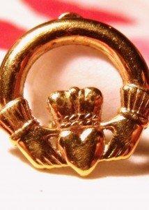 Gold Claddagh design earring