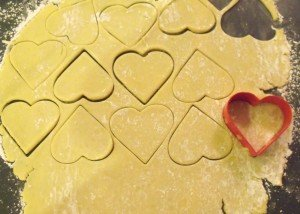 Cookie dough rolled and cut out with heart shape cutter