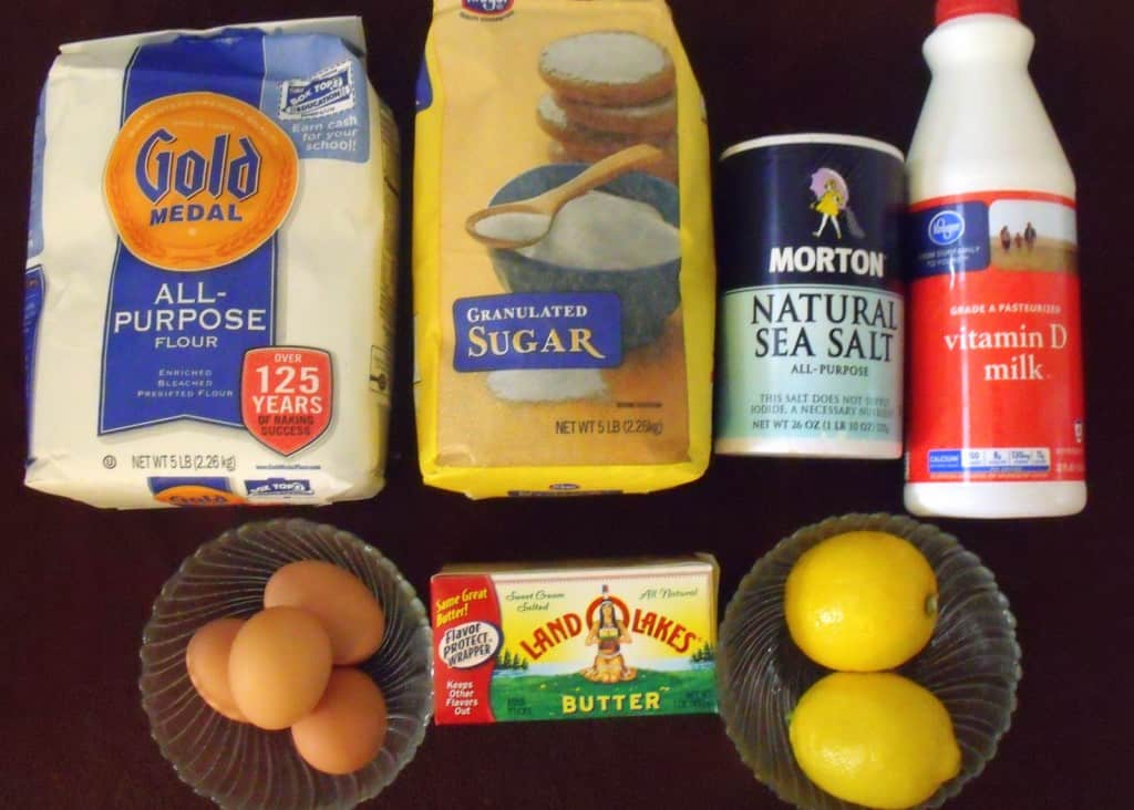 Flour, salt, milk, eggs, butter, sugar and lemon for Irish pancakes