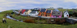 Thatched cottages on Fisher Street Doolin opposite a river